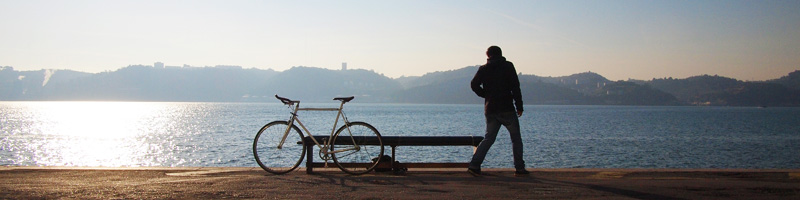 a bike and a guy by the seashore