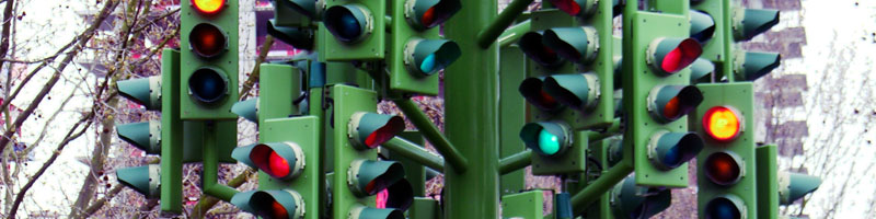 picture showing large amount of traffic lights representing the many lessons learned of pmp exam